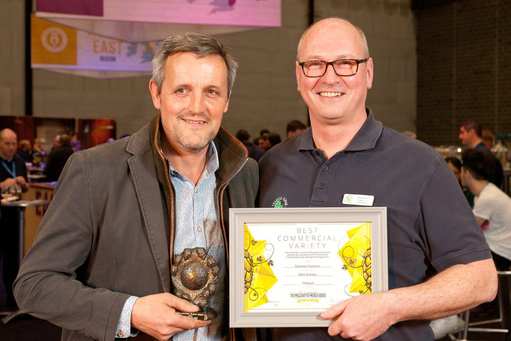 Photo of Mark Andrews accepts the Supreme Champion Gold award for Harlequin from Paul Corbett, MD Charles Faram