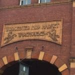 """Photo of the entrance to the hop warehouses. The signage says """"Worcester hop market warehouses"""""""