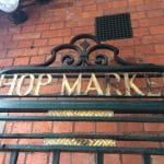 Photo of the old hop market gates painted in black and gold